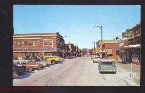 FOREST CITY IOWA DOWNTOWN STREET SCENE OLD CARS GLIDDEN PAINT SIGN POSTCARD