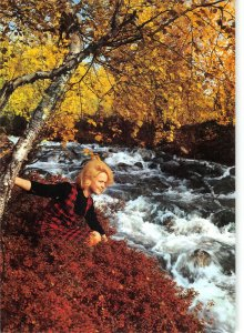 B109487 Finland By foaming Rapids Woman, River Autumn Trees