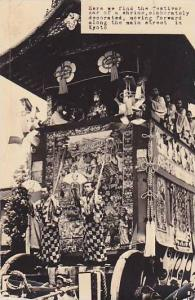 RP; Festival car of a shrine, elaborately decorated, moving forward along the...