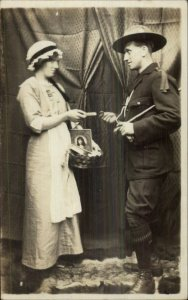 Scouts Young Man & Woman Selling Items c1910 Real Photo Postcard