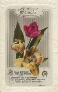 A happy birthday greetings tulips flowers embossed borders postcard