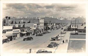 Anchorage AK Street View Store Fronts Old Cars Trucks RPPC Postcard