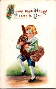 Cute little boy with adorable brown bunny & basket Easter vtg postcard