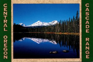 Oregon Scott Lake Reflecting Three Sisters Mountains