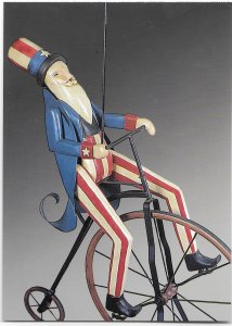 US Patriotic Postcard. Uncle Sam waving Liberty Flag. issued 2003