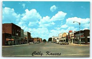 Postcard KS Colby 1950's Franklin Avenue Street View Old Cars Ford Dealer A23