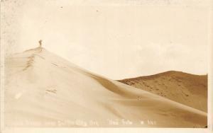 F25/ Pacific City Oregon RPPC Postcard c1920s Sand Dunes Hiker