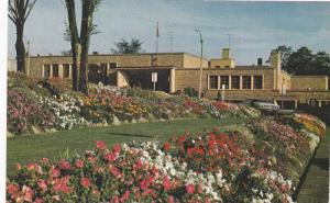 Exterior,  McLaughlin Public Library, with a beautiful flower garden in the f...