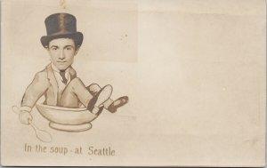 'In The Soup at Seattle' WA Washington Man Hat Sitting in Bowl RPPC Postcard F88