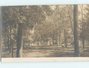 Pre-1918 rppc SWING SET IN WOODED AREA BEHIND THE HOUSE HL9901