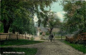 Chester PA~Horse Buggy on Dirt Road Along Chester Creek~Fences~1910 Postcard