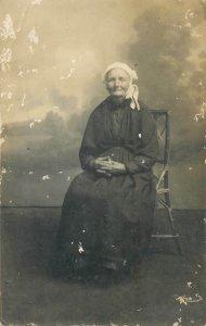 Postcard senior citizen sitting old lady picture