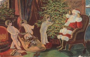 CHRISTMAS, 1900-10s ; Santa Claus gets help up by kids in masks