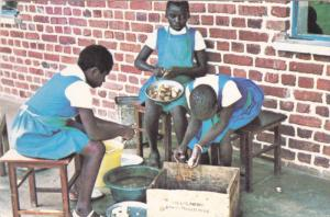 Blind Girls peeling Potatoes , TANZANIA , 50-70s