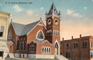 Hicksville Ohio~United Brethren Church~Shops on Both Sides~1908 Postcard