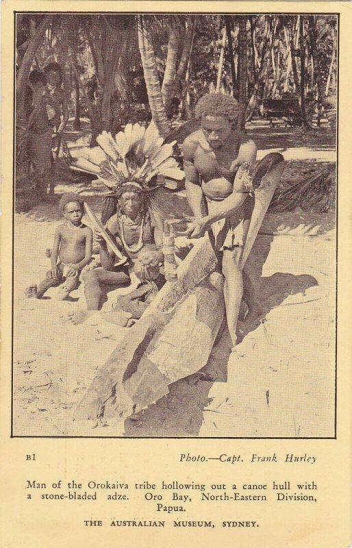 ORO BAY, NE Division, PAPUA , 00-10s ; Orokaiva tribe man carving a canoe