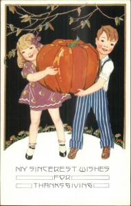 Thanksgiving c1910 Postcard - Boy & Girl Giant Pumpkin - ART DECO