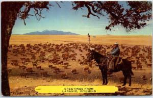 Laramie, Wyoming Postcard Greetings Cowboy on Horse Cattle Drive c1950s Unused