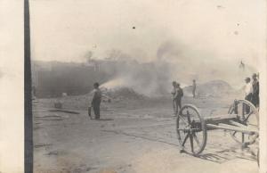Real Photo Postcard~Folks Gathered Around Smoking Piles~Train~Wagon~c1912 RPPC