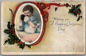 1910s HAPPY CHRISTMAS Greetings Postcard Baby Girl Back-to-Back with Doll