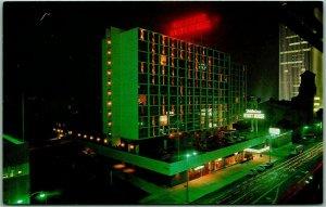 Los Angeles, California Postcard WILSHIRE HYATT HOUSE Night Scene c1960s Unused