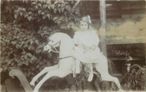 Girl rocking horse vintage real photo postcard