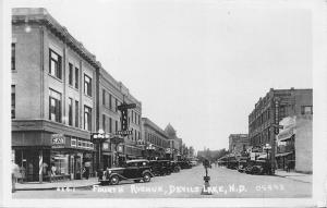 DEVILS LAKE NORTH DAKOTA~FOURTH AVENUE-STOREFRONT BUSINESS-REAL PHOTO POSTCARD