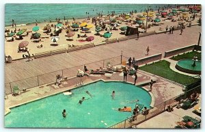 Postcard DE Rehoboth Beach View of Boardwalk Beach and Swimming Pool D10