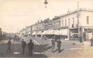 Lemars IA~Dry Goods~Corner 6th & Main~Men Meander~Hanging Light~Dabbs RPPC 1912