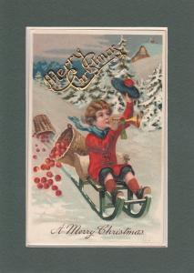 PFB Christmas~Boy On Sled Blows Horn~Apple Baskets~Ad On Gold Merry Xmas~Emboss