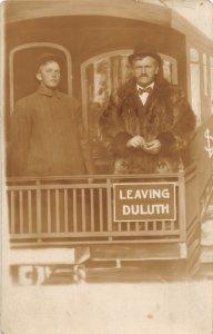 H37/ Duluth Minnesota RPPC Postcard c1910 Studio Railroad Men Fur Coat