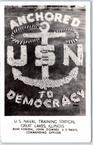 RPPC  GREAT LAKES, IL    U.S.N.  Sailors Posed  ANCHORED TO DEMOCRACY  Postcard