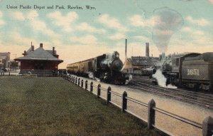 RAWLINS , Wyoming , 1910 ; Union Pacific Railroad Depot with trains