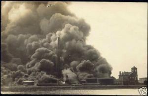 suriname (?), Oil Refinery on Fire, Church (1930s) RPPC
