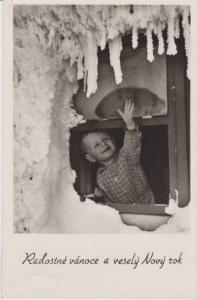 RP: Smiling Blond Boy Reaching Out Window to Touch Snowy Icicles 1960s