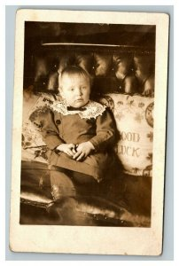 Vintage 1910's RPPC Cute Blonde Child in Dress on Living Room Couch
