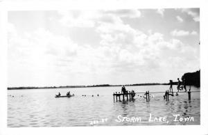 Storm Lake Iowa~Lake Scene~Kids Running on Dock~Boat on Water~1950s RPPC