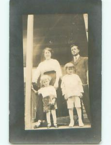 Pre-1918 rppc FAMILY STANDING ON THE PORCH o2021