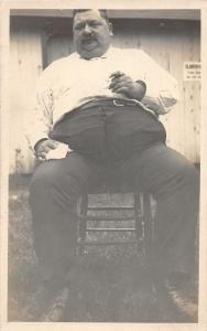 F37/ Interesting Real Photo RPPC Postcard c1910 Fat Man Smoking Cigar Chair