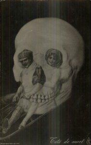 Metamorphic Skull Fantasy Sledding FETE DE MORT c1910 Real Photo Postcard