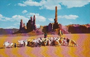 Indian Navajo Women Taking Their Sheep To Water In Beautiful Monument Valley
