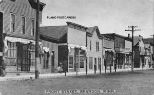 BRANDON, MINNESOTA FRONT STREET-LADY PUSHING STROLLER-EARLY 1900'S