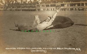 1919 Belle Fourche South Dakota Real Photo Postcard: Norman Mason Bulldogging