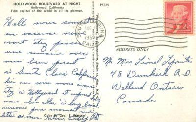Hollywood Boulevard at Night, California, 1957 used Postcard