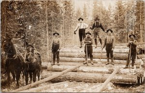 Portrait of 'Skidding Gang' Loggers Logging 6 Men Unknown Loc RPPC Postcard F93