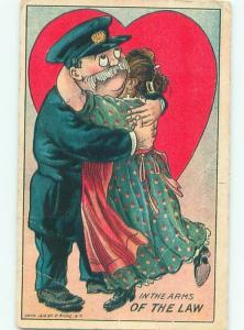 Pre-Linen Valentine WOMAN HUGS POLICE OFFICER AB3058