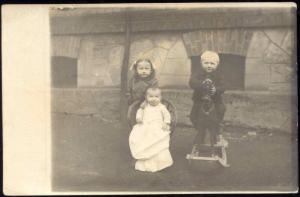 Baby and Two Young Children with Rocking Horse (1910s) RPPC