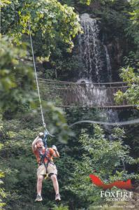 SEVIERVILLE, Tennessee, 2010s; Fox Fire Mountain, Man on Zipline, Waterfall