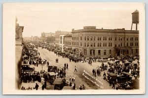 Albert Lea~Gulbrandson's~Crowd For Parade?~Buggies & Cars~Water Tower~RPPC 1911