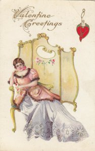 VALENTINE'S DAY, 1900-10s; Woman lounging on seat holding a Valentine Greetings